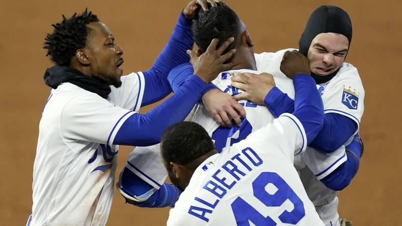 Kansas City Royals' Salvador Perez, top center, celebrates with teammates after hitting a...