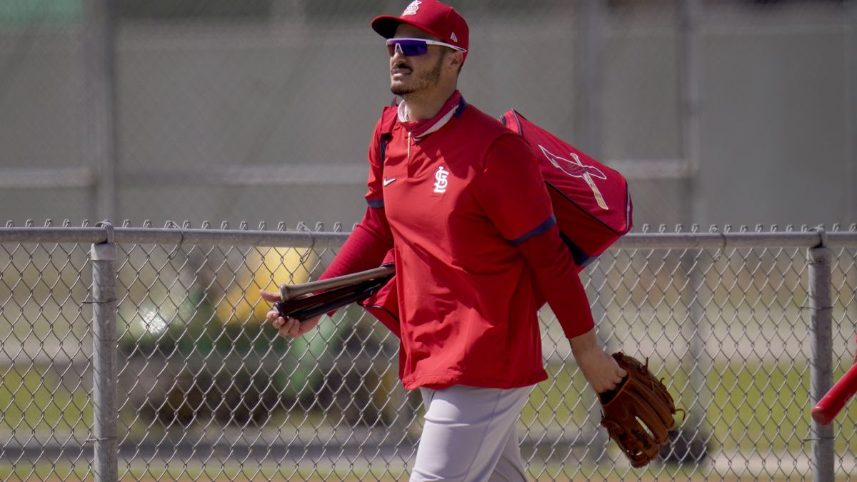 St. Louis Cardinals infielder Nolan Arenado heads out to a spring training baseball practice...