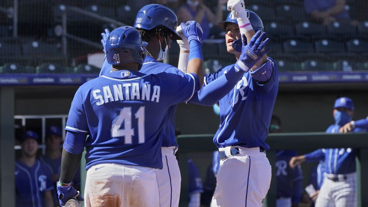 Kansas City Royals' Bobby Witt Jr., right, celebrates his home run with Seuly Matias, center,...