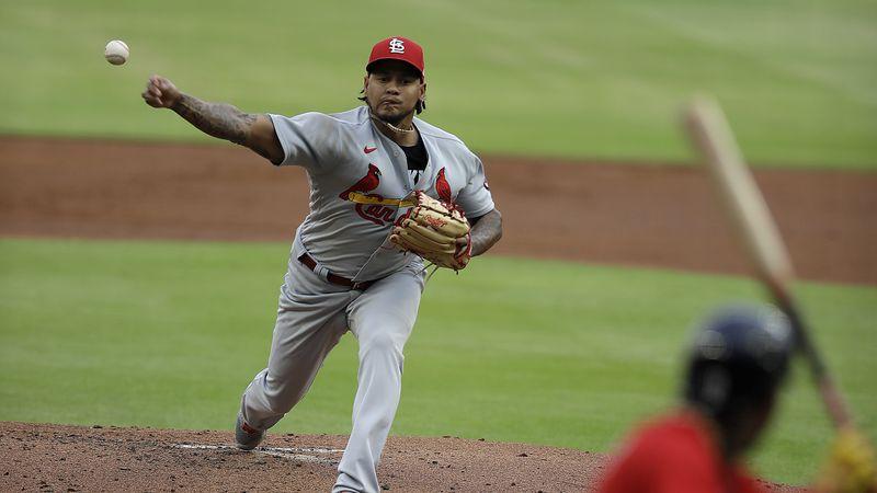 St. Louis Cardinals pitcher Carlos Martínez, left, pitches to Atlanta Braves' Ronald Acuna Jr....