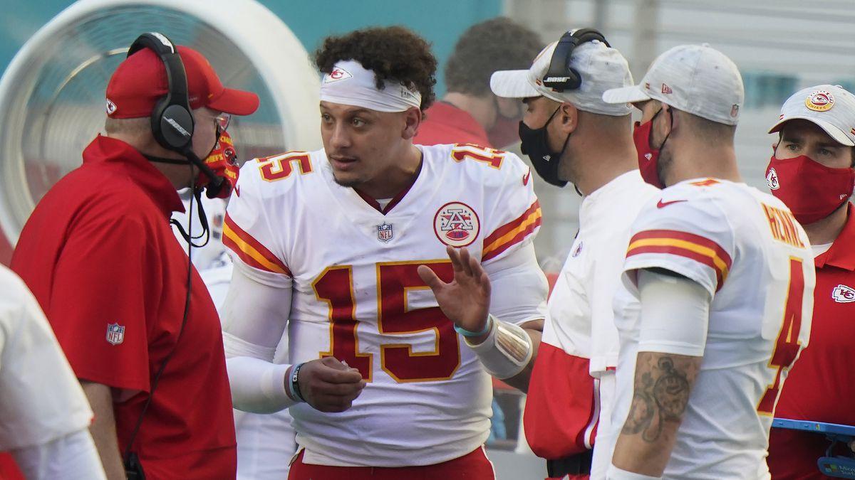 Kansas City Chiefs quarterback Patrick Mahomes (15) talks to head coach Andy Reid on the...
