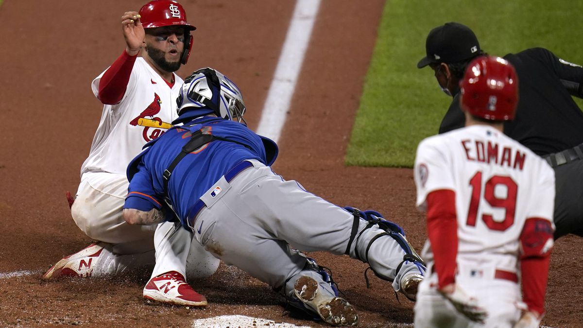 St. Louis Cardinals' Ali Sanchez, left, is tagged out at home by New York Mets catcher Tomas...