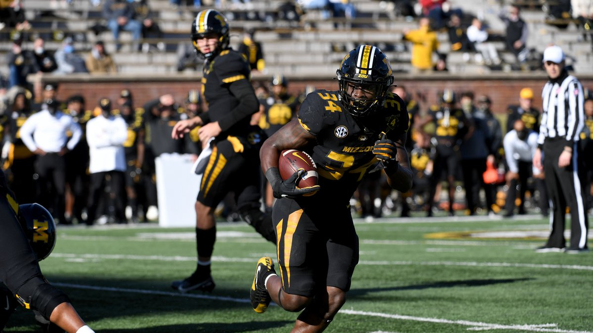 Missouri running back Larry Rountree III scores on a touchdown run during the first half of an...
