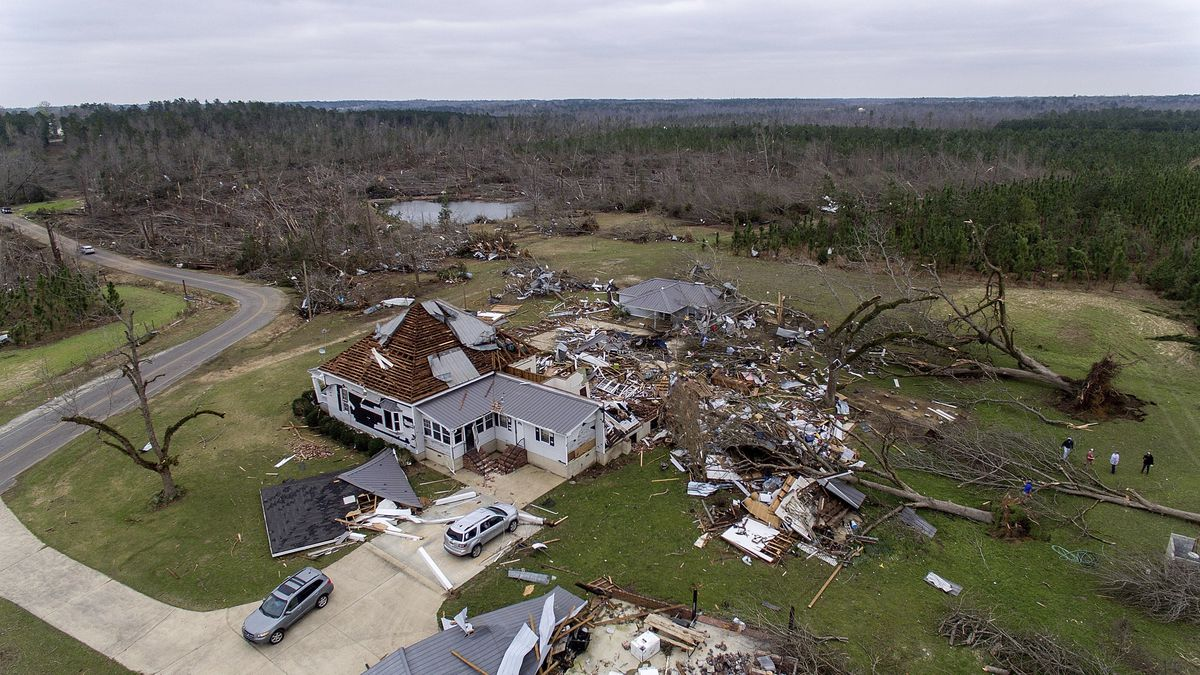 Debris litters a property after a home was damaged by a tornado a day earlier in Beauregard, Ala., Monday, March 4, 2019. (AP Photo/David Goldman)