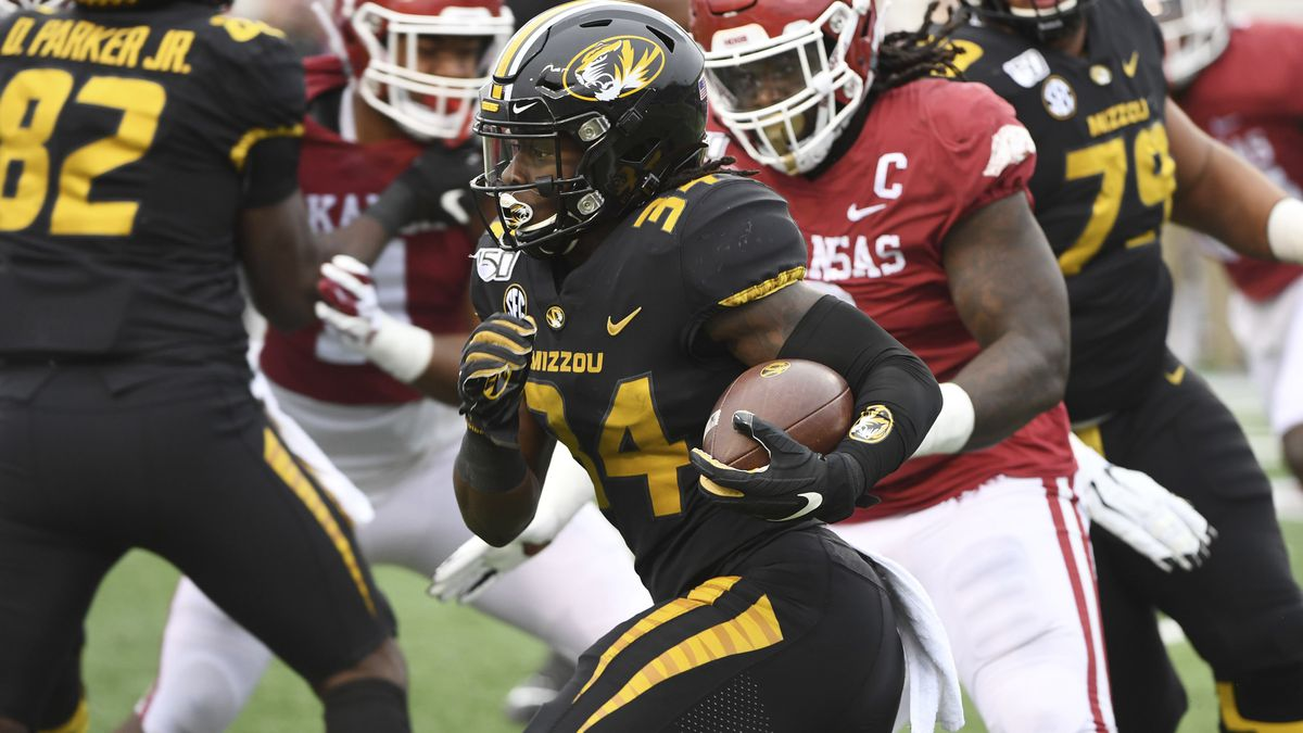 Missouri running back Larry Rountree III finds a hole in the Arkansas defense as he runs the...