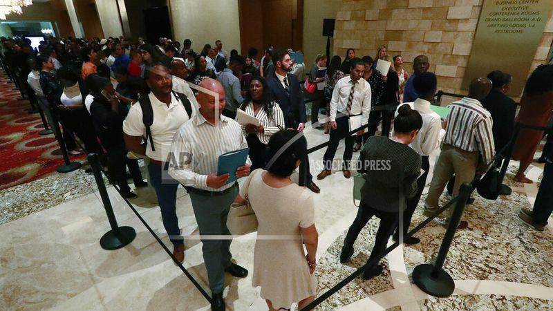 In this Tuesday, June 4, 2019 photo, job applicants line up at the Seminole Hard Rock Hotel...