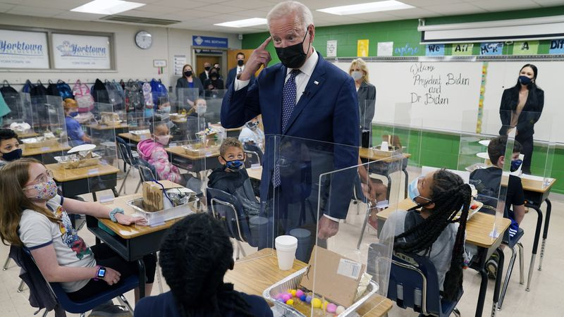 In this May 3, 2021, photo, President Joe Biden gestures as he talks to students during a visit...