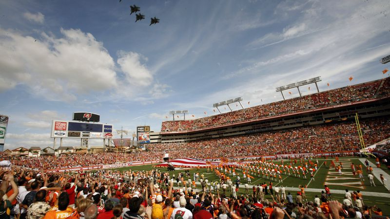 FILE - Tampa Bay Buccaneers fans cheer during a military fly over before an NFL football game...