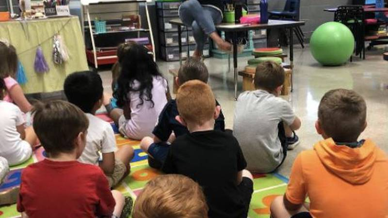 Danae Rader is reading to her 1st grade class at Springfield Public Schools.