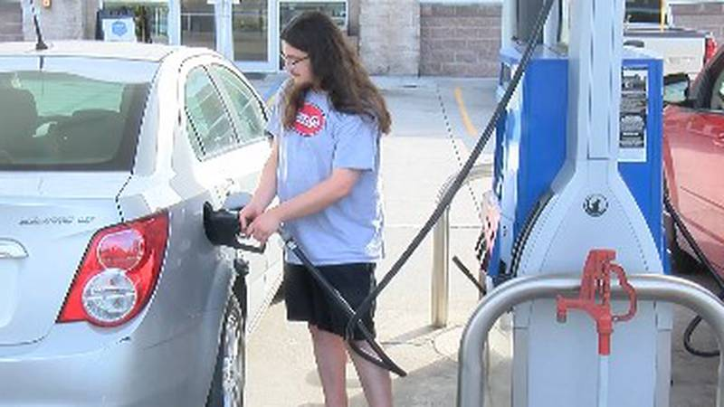 A local man buys gas at Kidds on Broadway.