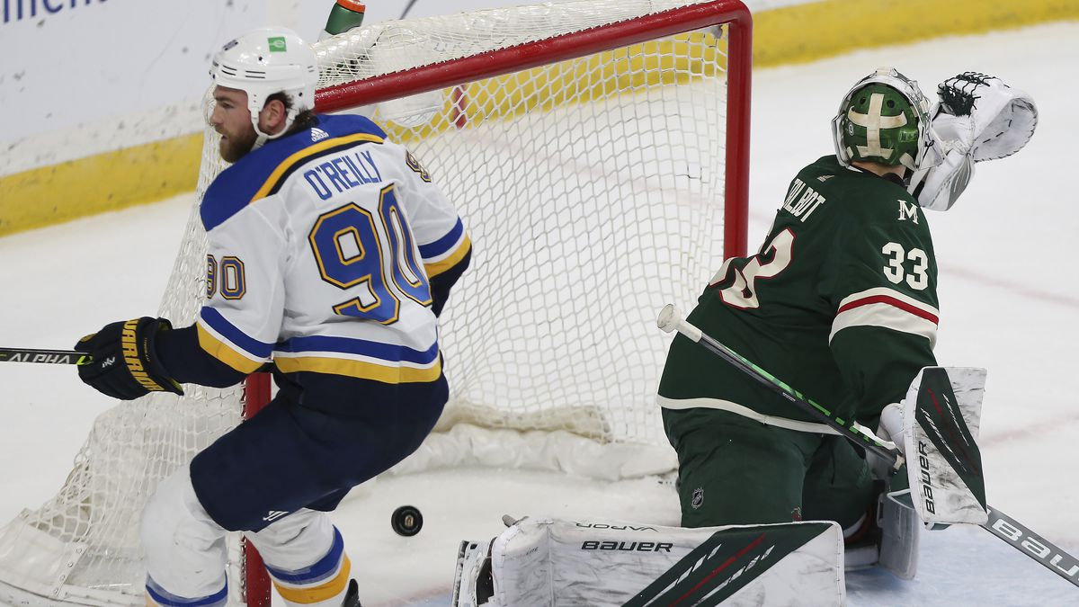 St. Louis Blues' Ryan O'Reilly (90) skates past the puck in the net after scoring a goal...