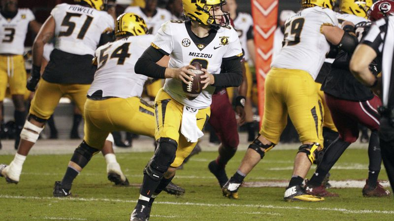 Missouri quarterback Connor Bazelak (8) looks for an open receiver during the second half of an...