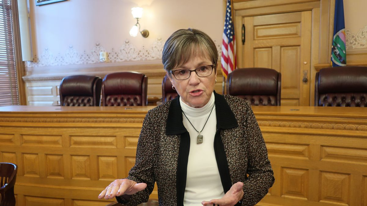 Kansas Gov. Laura Kelly answers questions from reporters following a meeting with legislative leaders about budget issues, Friday, June 26, 2020, at the Statehouse in Topeka, Kan. The Democratic governor is locked in a partisan dispute with the Republican-controlled Legislature over her plan to close a projected shortfall tied to the coronavirus pandemic. (AP Photo/John Hanna)