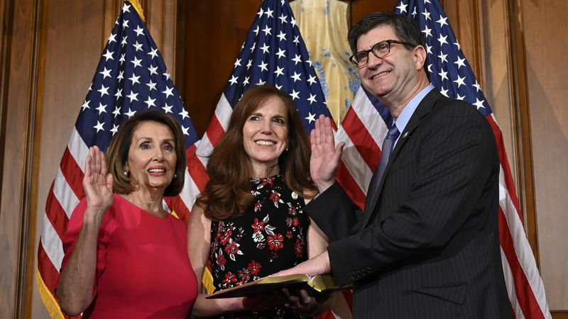 House Speaker Nancy Pelosi of Calif., left, poses during a ceremonial swearing-in with Rep....