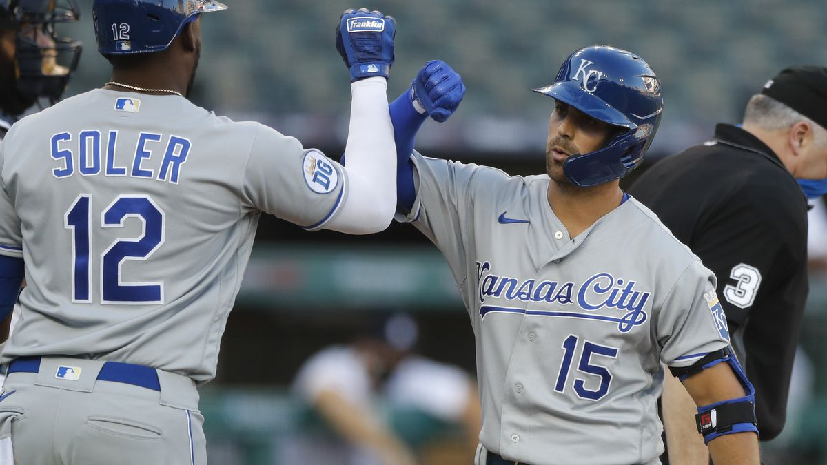 Kansas City Royals' Whit Merrifield(15) is greeted by Jorge Soler after hitting a three-run...