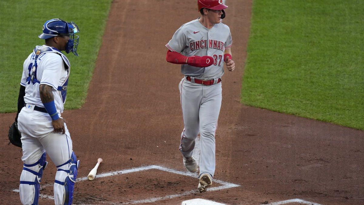 Cincinnati Reds' Tyler Stephenson runs home past Kansas City Royals catcher Salvador Perez to...