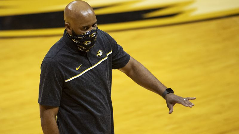 Missouri coach Cuonzo Martin talks to players on the bench during the first half of the team's...