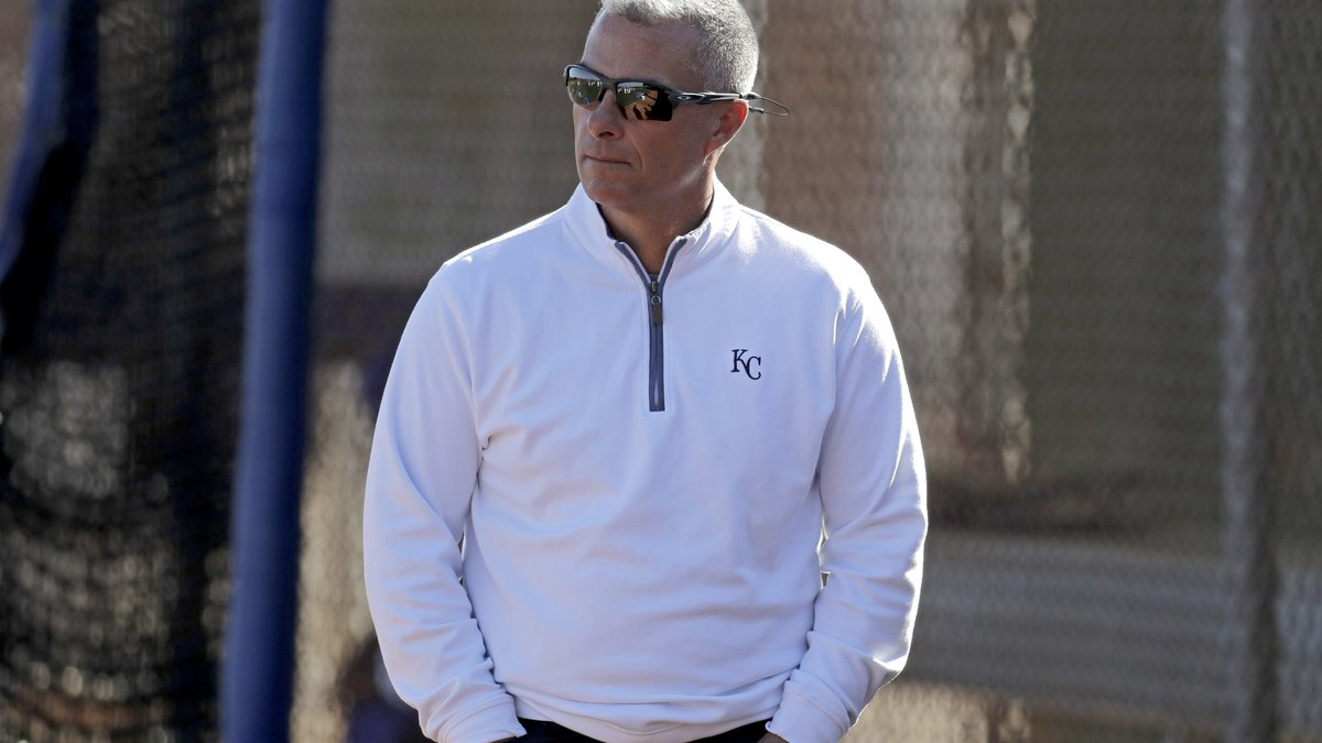 Kansas City Royals general manager Dayton Moore watches a workout during spring training...