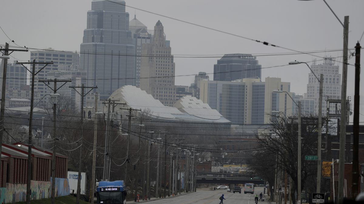 Light traffic is seen on a major street leading out of downtown Kansas City, Mo. during rush...