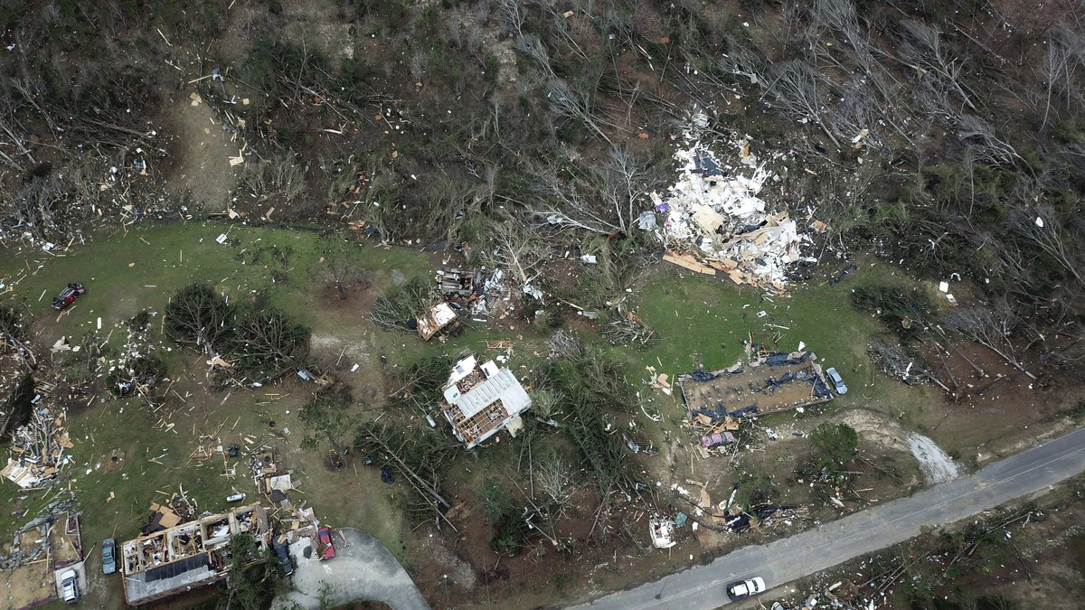 This aerial photo shows damage caused by Sunday's powerful tornado in Beauregard, Ala.,...