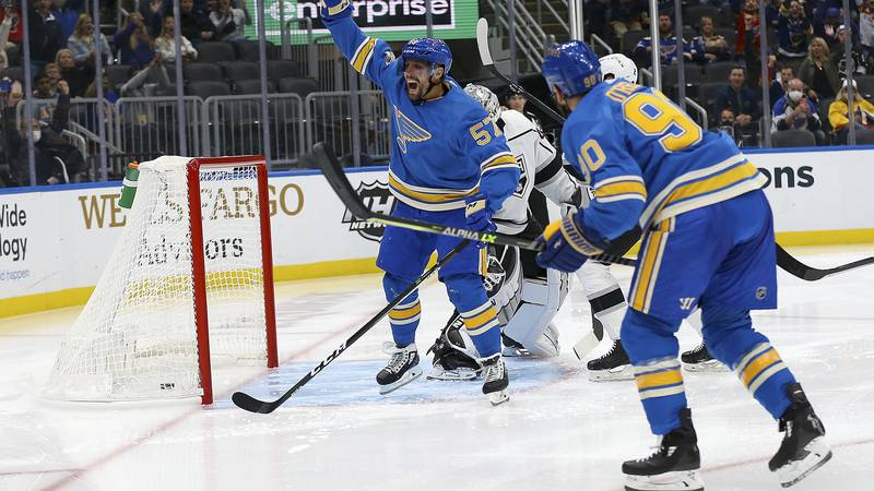 St. Louis Blues' David Perron (57) celebrates after scoring a goal during the second period of...